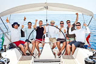 happy-sailing-crew-on-sailboat-2