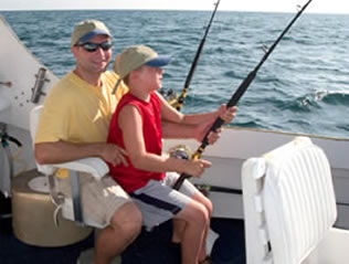 father son boy on charter fishing boat